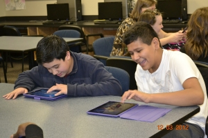 Student Using iPads to learn math concepts.